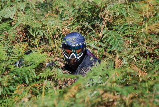 Paintballer hiding in the bushes